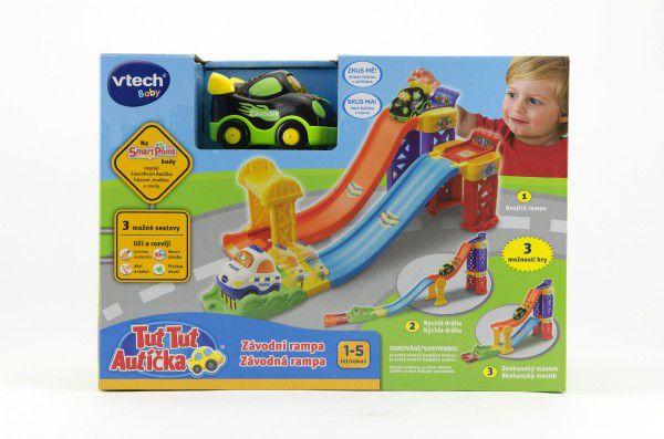 Tut Tut Závodní rampa+autíčko 8cm plast na baterie se zvukem se světlem v krabici 30x21x11cm Vtech