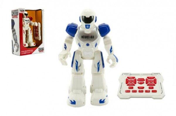 Robot chodící a tancující s ovladačem na baterie + USB kabel plast 25cm v krabici 25x32x11cm